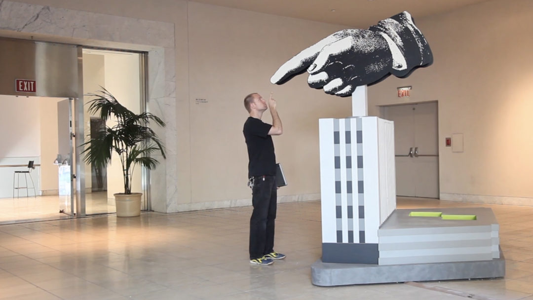 GIANT HAND GUY POINTING FROM MOV_16x9